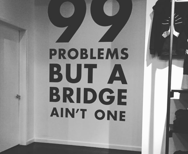 Wall that says 99 Problems but a bridge ain't one at Y7