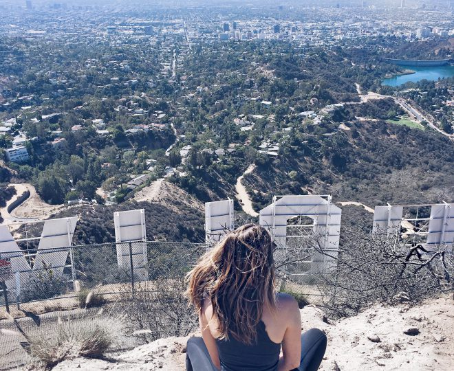 Erin sitting behind the Los Angeles Hollywood sign