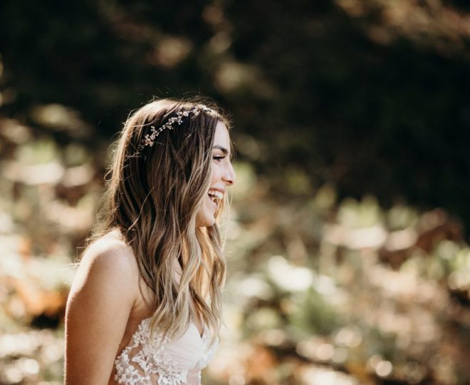 Erin laughing while in her wedding gown