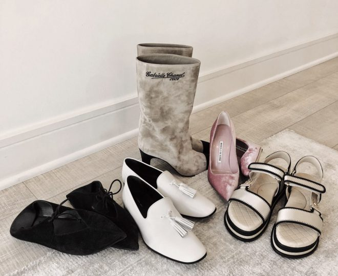5 pairs of designer shoes arranged on the floor.