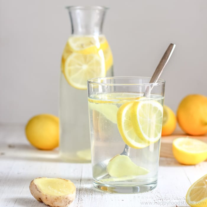 glass of water with lemon slices in it